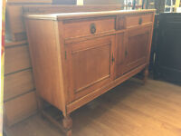 Large oak sideboard- Lovely carved detail- 2 drawers and lower cupboard space