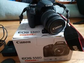 Canon 550D camera body and kit lens with camera bag