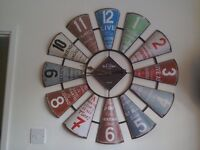 A large, colourful, shabby chic clock