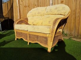 Cane conservatory two seater sofa.