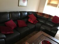 Corner sofa and electric recliner chair.