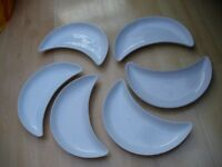 12 Various different shaped white oven serving dishes