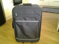Black 2 wheeled lightweight suitcase.