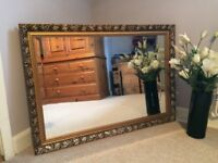 Ornate gold mirror with bevel edge glass