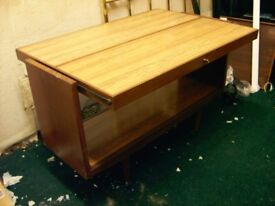 RETRO DINING TABLE WITH CANTILEVER FOLDING TOP. WITH CASTORS. 1950'S OR 1960'S. TEAK AND FORMICA.