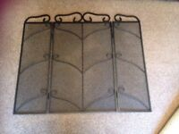 Black wrought iron fire guard