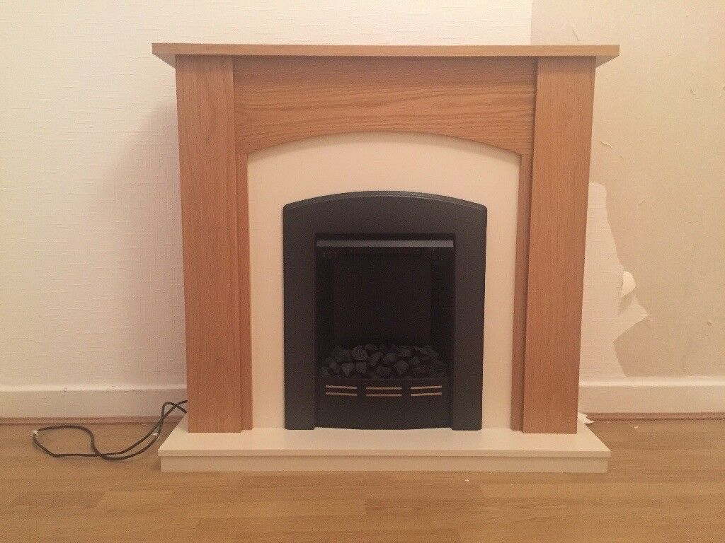 Pine surround with cream electric fireplace and 5 internal doors