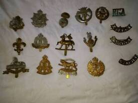 17 assorted military badges used
