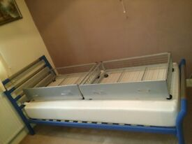 Blue and silver singled bed with easy access storage