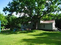 renovated farm house sitting on just over 2.5 private acres