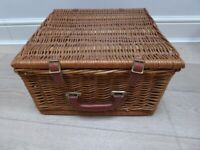Wicker picnic basket with crockery, cutlery etc for 2. Excellent condition. Never used.