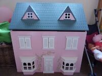 Wooden dolls house in fantastic condition with lots of furniture