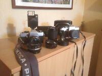 Two Praktica Cameras and assorted Lenses