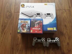 Sony Playstation 4 Silver 500gb with 2 pads and 2 games