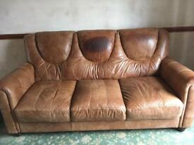 Large 3 seater real leather sofa in tan colour.