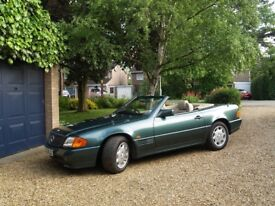 1994 Mercedes Benz 280 SL Automatic. Dark green convertible plus hard top. Immaculate throughout.