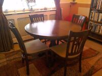 TABLE AND 4 CHAIRS. Great condition selling as buying a different colour and wood