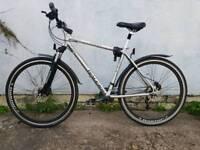 Raleigh Pioneer Hybred Mountain Road Bike
