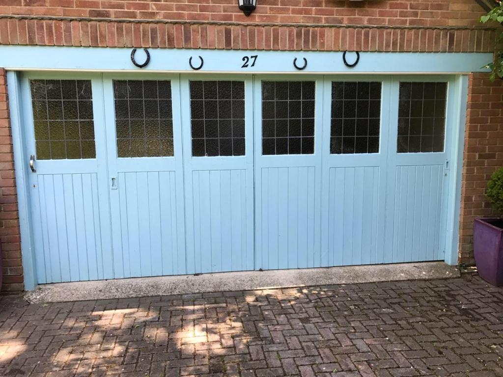 folding garage doors. Solid Wood Sliding Folding Garage Door Glazed In West Moors Doors O