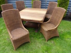 SOLID OAK TABLE/ 6 SOLID HIGH BACK WICKER CHAIRS