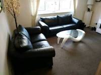 Lovely real leather black 3&2 sofa suite