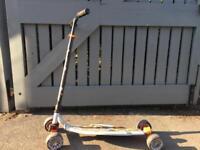 Oxelo Orange scooter board.