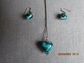 Turquoise glass necklace and earrings.