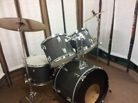 Retired drum teacher has a student drum kit complete with upgraded cymbals for sale.