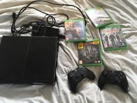 Xbox one console, the division, battlefield 1, forza2, evolve, and a couple of controllers