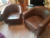 Pair of brown faux leather tub chairs in good condition