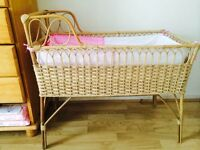 A natural bamboo crib/bassinet with bumper and matress with cover