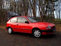 TOYOTA COROLLA SE 1.3 16 VALVE 3 DOOR IN GLEAMING RED, MOT TO JULY 2017, ONLY 82,225 MILES VERY TIDY