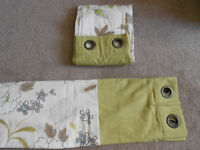Flowered curtains with a green border