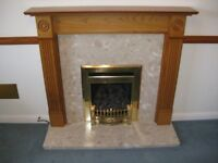 Wooden fire surround with marble effect hearth and back plate