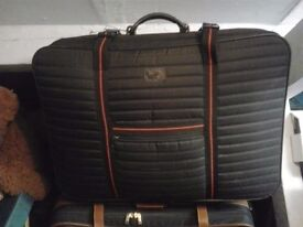 5 Suitcases for sale