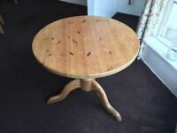 Circle table with two chairs.