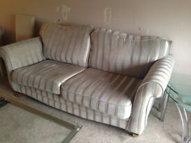 2 Three seater sofas in Regency stripe colour is beige and gold