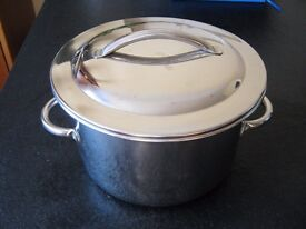 Stainless steel pan and lid. Not sure what its for!