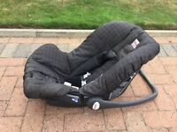 Britain Rock-a-Tot Car Seat.