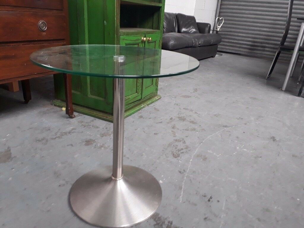 Chrome and glass side table 60 cm diameter. Delivery can be arranged if required.