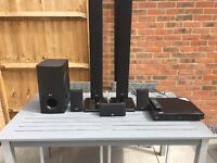 LG Blu-ray player with LG surround sound speaker system (6 speakers) complete with remote