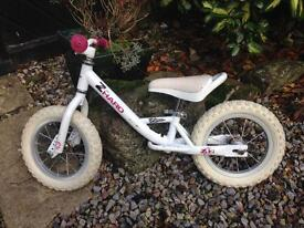 White and pink balance bike