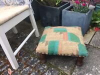 Small Fabric foot stool with wooden legs. Good condition.