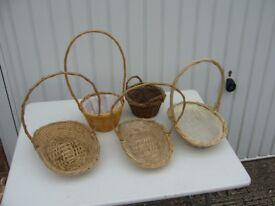 Five small wicker baskets