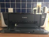 A black and silver printer in excellent condition