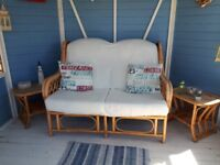 Wicker two seater and two side tables