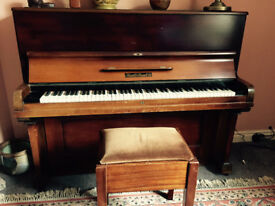 Overstrung upright piano by Russell and Russell with stool