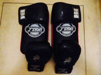 Boxing gloves and pads (2 pairs of gloves and 2 pads)