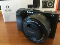 Sony A6000 dual lens kit, case, tripod, camera bag, extra battery and charger and memory card