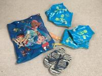 Swim bag, Havaiana flip flops (around size 11), 2 pairs Speedo armbands